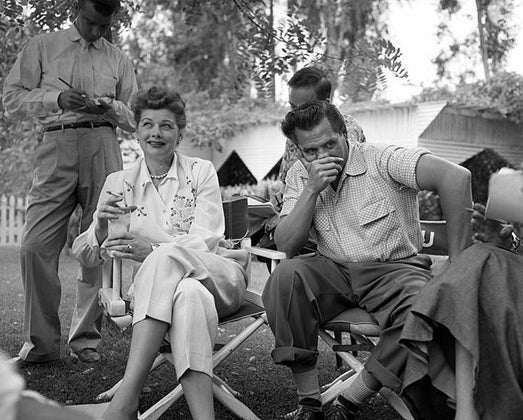 lucille ball and desi arnaz sitting in chairs