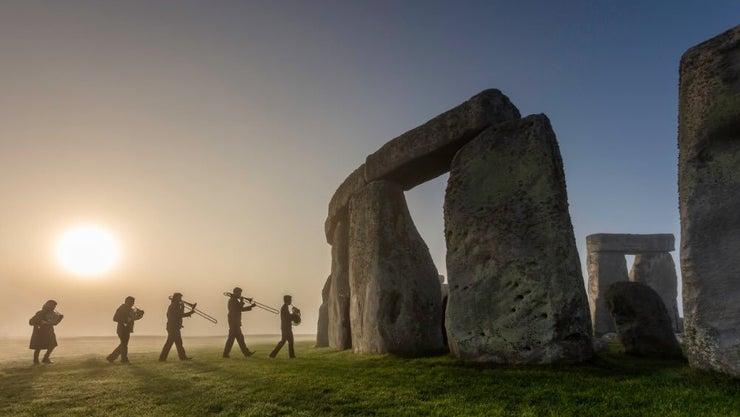 Band celebrating at Stonehenge