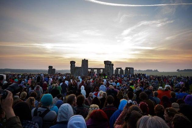 Many people enjoying view of Stonehenge