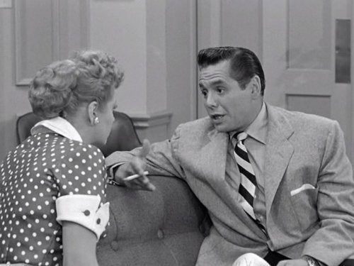 lucille ball and desi arnaz with cigarette