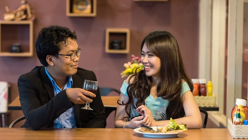 A man and woman sitting together in a restaurant or bar