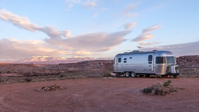 A silver mobile home in the desert